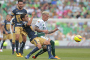 Luis Fuentes of Pumas, (L) and Brian Lozano of Santos fight for the ball during the 16th round match between Santos Laguna and Pumas UNAM as part of the Torneo Clausura 2018 Liga MX at Corona Stadium on April 22, 2018 in Torreon, Mexico.