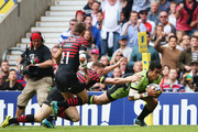 Chris Ashton of Saracens fails to stop George Pisi of Northampton Saints going over to score their second try during the Aviva Premiership Final between Saracens and Northampton Saints at Twickenham Stadium on May 31, 2014 in London, England.