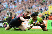 Chris Ashton of Saracens fails to stop George Pisi of Northampton Saints goes over to score their second try during the Aviva Premiership Final between Saracens and Northampton Saints at Twickenham Stadium on May 31, 2014 in London, England.