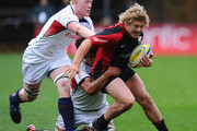 Jared Saunders of Saracens is tackled by Scott Lavalla (L) and Mike Petri of USA during the friendly match between Saracens and USA at the Honourable Artillery Company on November 9, 2010 in London, England.