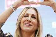Sarah Jessica Parker gestures to fans at Highpoint Shopping Centre on October 23, 2019 in Melbourne, Australia.