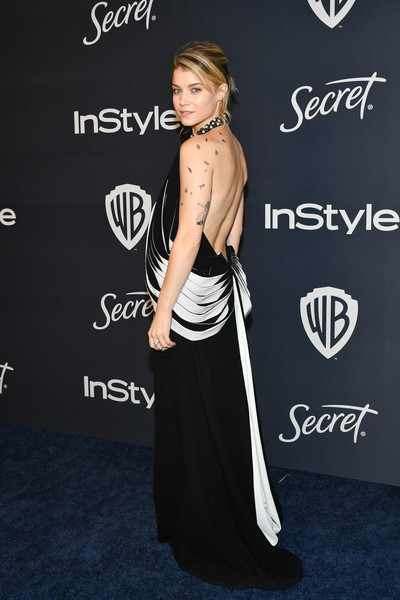 21st Annual Warner Bros. And InStyle Golden Globe After Party - Arrivals [shoulder,clothing,dress,premiere,fashion,joint,carpet,strapless dress,little black dress,gown,sarah jones,beverly hills,california,the beverly hilton hotel,warner bros,instyle golden globe,instyle golden globe after party,arrivals,golden globe awards,hollywood,stock photography,celebrity,instyle,warner bros.,photograph,fashion]