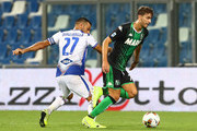 Manuel Locatelli (R) of US Sassuolo is challenged byl with Fabio Quagliarella (L) of UC Sampdoria during the Serie A match between US Sassuolo and UC Sampdoria at Mapei Stadium - Citta del Tricolore on September 1, 2019 in Reggio nell'Emilia, Italy