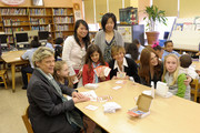 Actress Julianne Moore (2nd R), President of the American Federation of Teachers, Randi Weingarten (3rd R) and Save the Children Board Vice Chair, Cokie Roberts (L) pose with students honored during the Save The Children Valentine?s Day Contest Winners Lunch at The Harriet Tubman School, C.S. 154 on January 28, 2010 in New York City.