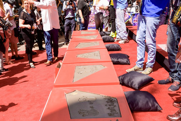 Scarlett Johansson Chris Evans Marvel Studios' 'Avengers: Endgame' Cast Place Their Hand Prints In Cement At TCL Chinese Theatre IMAX Forecourt