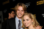 """Actors Graham Rogers (L) and Allie Grant arrive at a screening of Tribeca Film's """"Struck By Lightning"""" at the Chinese Cinema 6 Theaters on January 6, 2013 in Los Angeles, California."""