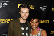 "Actors Reid Ewing (L) and Danielle Watts arrive at a screening of Tribeca Film's ""Struck By Lightning"" at the Chinese Cinema 6 Theaters on January 6, 2013 in Los Angeles, California."