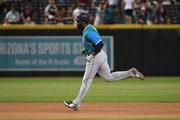 Denard Span #4 of the Seattle Mariners rounds the bases after hitting a solo home run during the tenth inning against the Arizona Diamondbacks at Chase Field on August 25, 2018 in Phoenix, Arizona. All players across MLB will wear nicknames on their backs as well as colorful, non-traditional uniforms featuring alternate designs inspired by youth-league uniforms during Players Weekend.