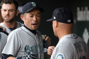 Ichiro Suzuki #51 of the Seattle Mariners talks with teammates in the dugout before the game against the Baltimore Orioles at Oriole Park at Camden Yards on June 27, 2018 in Baltimore, Maryland.