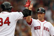 Daniel Nava #66 of the Boston Red Sox is congratulated by teammate David Ortiz #34 after Nava scored in the fourth inning against the Seattle Mariners on May 15, 2012 at Fenway Park in Boston, Massachusetts.