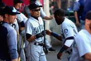 Ichiro Suzuki #51 talks with Guillermo Heredia #5 of the Seattle Mariners prior to a game against the Los Angeles Angels of Anaheim at Angel Stadium on July 12, 2018 in Anaheim, California.