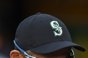 Ichiro Suzuki #51 the Special Assistant to the Chairman of the Seattle Mariners in the dugout laughing prior to the start of the game against the Oakland Athletics at Oakland Alameda Coliseum on August 14, 2018 in Oakland, California.