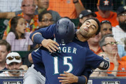 Kyle Seager #15 of the Seattle Mariners is hugged by Nelson Cruz #23 after hitting a home run in the sixth inning against the Houston Astros at Minute Maid Park on September 19, 2018 in Houston, Texas.