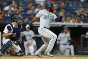 Denard Span #4 of the Seattle Mariners hits a single in the fourth inning and Kyle Seager #15 scores on a throwing error by Gleyber Torres #25 of the New York Yankees at Yankee Stadium on June 20, 2018 in the Bronx borough of New York City.