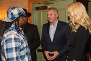 (L-R) Seattle Seahawks Running Back Marshawn Lynch, retired NFL quarterback Joe Montana and Jennfer Montana attend the FAM 1st FAMILY FOUNDATION Charity Event at The Edgewater Hotel on December 14, 2014 in Seattle, Washington.