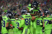 Tight end Jimmy Graham #88 of the Seattle Seahawks celebrates a six yard touchdown with teammates in the first half against the Arizona Cardinals at University of Phoenix Stadium on November 9, 2017 in Glendale, Arizona.
