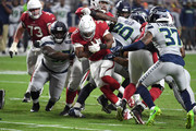 David Johnson #31 of the Arizona Cardinals runs the ball past cornerback Tre Flowers #37 of the Seattle Seahawks during the second quarter at State Farm Stadium on September 30, 2018 in Glendale, Arizona.