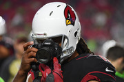 Wide receiver Larry Fitzgerald #11 of the Arizona Cardinals takes a photo with a fans camera prior to the NFL game against the Seattle Seahawks at University of Phoenix Stadium on November 9, 2017 in Glendale, Arizona.