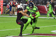 Tight end Jimmy Graham #88 of the Seattle Seahawks scores a six yard touchdown against strong safety Tyvon Branch #27 of the Arizona Cardinals in the first half at University of Phoenix Stadium on November 9, 2017 in Glendale, Arizona.