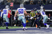 Jeff Heath #38 of the Dallas Cowboys; Sean Lee #50 of the Dallas Cowboys and Jourdan Lewis #27 of the Dallas Cowboys are unable to keep Jimmy Graham #88 of the Seattle Seahawks from making a touchdown reception in the first half of a football game at AT&T Stadium on December 24, 2017 in Arlington, Texas.