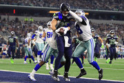 Jimmy Graham #88 of the Seattle Seahawks pulls in a touchdown against Jourdan Lewis #27 of the Dallas Cowboys and Jeff Heath #38 of the Dallas Cowboys at AT&T Stadium on December 24, 2017 in Arlington, Texas.