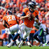 Case Keenum Photos - Quarterback Case Keenum #4 of the Denver Broncos rolls out of the pocket against the Seattle Seahawks at Broncos Stadium at Mile High on September 9, 2018 in Denver, Colorado. - Seattle Seahawks vs. Denver Broncos