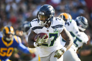 Running back Mike Davis #27 of the Seattle Seahawks moves the ball in the game against the Los Angeles Rams at Los Angeles Memorial Coliseum on November 11, 2018 in Los Angeles, California.