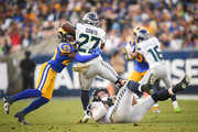 Running back Mike Davis #27 of the Seattle Seahawks is tackled by defensive back Nickell Robey-Coleman #23 of the Los Angeles Rams in the fourth quarter at Los Angeles Memorial Coliseum on November 11, 2018 in Los Angeles, California.