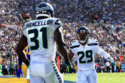Kam Chancellor #31 celebrates a broken pass play with  Earl Thomas #29 of the Seattle Seahawks during the second half of a game against the Los Angeles Rams   at Los Angeles Memorial Coliseum on October 8, 2017 in Los Angeles, California.