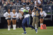 Rondey Smith #86 of the Seattle Seahawks catches a touchdown pass against the Oakland Raiders during the first quarter of their game at the Oakland-Alameda County Coliseum on August 31, 2017 in Oakland, California.