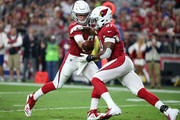 Quarterback Josh Rosen #3 of the Arizona Cardinals hands the ball off to running back David Johnson #31 of the Cardinals during an NFL game against the Seattle Seahawks at State Farm Stadium on September 30, 2018 in Glendale, Arizona.