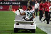 Defensive back Earl Thomas #29 of the Seattle Seahawks gestures as he leaves the field on a cart after being injured during the fourth quarter against the Arizona Cardinals at State Farm Stadium on September 30, 2018 in Glendale, Arizona.