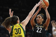 A'ja Wilson #22 of the Las Vegas Aces shoots against Breanna Stewart #30 of the Seattle Storm during the Aces' first-ever home game at the Mandalay Bay Events Center on May 27, 2018 in Las Vegas, Nevada. NOTE TO USER: User expressly acknowledges and agrees that, by downloading and or using this photograph, User is consenting to the terms and conditions of the Getty Images License Agreement.