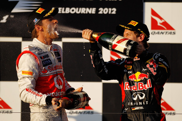 Sebastian Vettel Race winner Jenson Button (L) of Great Britain and McLaren celebrates with second placed Sebastian Vettel (R) of Germany and Red Bull Racing on the podium following the Australian Formula One Grand Prix at the Albert Park circuit on March 18, 2012 in Melbourne, Australia.