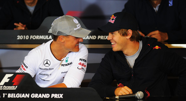 Sebastian Vettel Michael Schumacher (L) of Germany and Mercedes GP talks with Sebastian Vettel (R) of Germany and Red Bull Racing at the drivers press conference during previews to the Belgian Formula One Grand Prix at the Circuit of Spa Francorchamps on August 26, 2010 in Spa Francorchamps, Belgium.