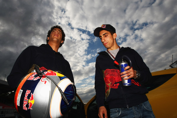 Sebastien Buemi Red Bull Racing test driver Daniel Ricciardo (L) of Australia is seen with Sebastien Buemi (R) of Switzerland and Scuderia Toro Rosso as the prepare to take members of the public for lap of the track following qualifying for the German Grand Prix at Hockenheimring on July 24, 2010 in Hockenheim, Germany.