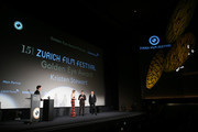 """Kristen Stewart, Max Loong and Benedict Andrews speak on stage ahead of the """"Seberg"""" premiere during the 15th Zurich Film Festival at Kino Corso on October 02, 2019 in Zurich, Switzerland."""