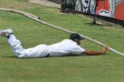 Imran Tahir of South Africa too late to stop the boundary during Day Two of the second Sunfoil Test match between South Africa and Sri Lanka at Sahara Park Kingsmead on December 27, 2011 in Durban, South Africa.