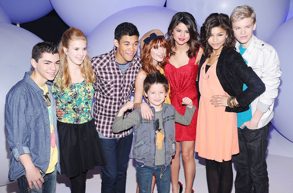 Selena Gomez (L-R) Actors Adam Irigoyen, Caroline Sunshine, Roshon Fegan, Davis Cleveland, Bella Thorne, Selena Gomez, Zendaya Coleman and Kenton Duty attend the 2011 Disney Kids & Family upfront at Gotham Hall on March 16, 2011 in New York City.