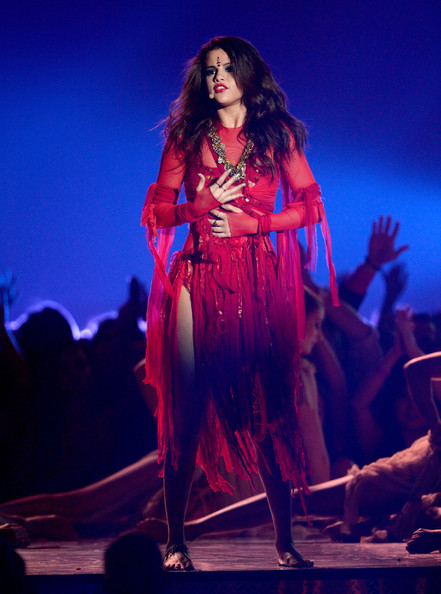 Selena Gomez Actress-singer Selena Gomez performs onstage during the 2013 MTV Movie Awards at Sony Pictures Studios on April 14, 2013 in Culver City, California.