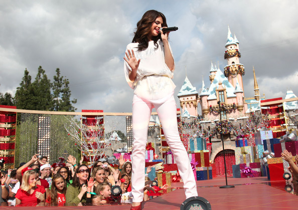 Selena Gomez In this handout image provided by Disney, 'Wizards of Waverly Place' star Selena Gomez performs 'Winter Wonderland' during the taping of the 2010 Disney Parks Christmas Day Parade on November 7, 2010 at Disneyland in Anaheim, California. The show airs Christmas Day, at various times across the country, on ABC. (Photo by Paul Hiffmeyer/Disney via Getty Images)..