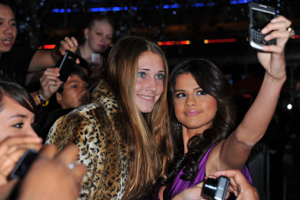 """Selena Gomez Selena Gomez and fan arrive at the premiere of Paramount Pictures' """"Justin Bieber: Never Say Never"""" held at Nokia Theater L.A. Live on February 8, 2011 in Los Angeles, California."""