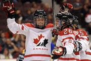 Sarah Vaillancourt #26 celebrates her goal with Gina Kingsbury #27 and Tessa Bonhomme #25 for a 1-0 lead over Sewden during the Semifinals of the Hockey Canada Cup on September 5, 2009 in Vancouver, Canada.