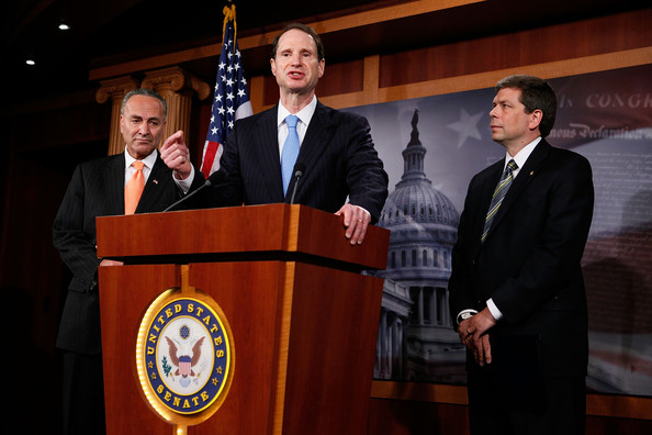 Ron Wyden U.S. Sen. Ron Wyden (D-OR) (C) speaks as Sen. Charles Schumer (D-NY) (L) and Sen. Mark Begich (D-AK) listen during a news conference June 15, 2010 on Capitol Hill in Washington, DC.  The senators called on BP to abandon its reported plans to set aside billions for a shareholder dividend until it proves it has enough funds to cover liabilities claims from the oil spill disaster in the Gulf of Mexico.