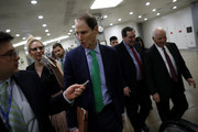 Sen. Ron Wyden (D-OR) speaks with reporters as he and Sen. Ben Cardin (D-MD), at right, and Sen. Joe Donnelly (D-IN), center, walk to a Democratic Caucus meeting at the U.S. Capitol January 19, 2018 in Washington, DC. A continuing resolution to fund the government has passed the House of Representatives but faces a stiff challenge in the Senate.