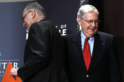 U.S. Senate Majority Leader Mitch McConnell (R-KY) (right) leaves the stage after introducing U.S. Senate Democratic Leader Chuck Schumer (D-NY) (left) at the University of Louisville's McConnell Center February 12, 2018 in Louisville, Kentucky. Schumer spoke at the event as part of the Center's Distinguished Speaker Series, and McConnell introduced him.
