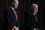 U.S. Senate Majority Leader Mitch McConnell (right) (R-KY) and U.S. Senate Democratic Leader Chuck Schumer (D-NY) stand on the stage together at the University of Louisville's McConnell Center where Schumer was scheduled to speak February 12, 2018 in Louisville, Kentucky. Sen. Schumer spoke at the event as part of the Center's Distinguished Speaker Series, and Sen. McConnell introduced him.