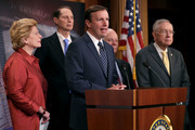 Sen. Chris Murphy (D-CT) speaks during a news conference with Senate Finance Committee members (L-R) Sen. Debbie Stabenow (D-MI), Sen. Ron Wyden (D-OR), Sen. Ben Cardin (D-MD) and Senate Minority Leader Harry Reid (D-NV) to call on Republicans to hold a vote on the Presidential Tax Transparency Act at the U.S. Capitol September 22, 2016 in Washington, DC. The proposed legislation would require presidential candidates to 'release their tax returns shortly after becoming the official nominees of their parties.'