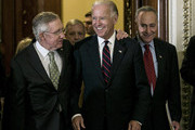 U.S. Sen. Harry Reid (D-NV) (L) and U.S. Sen. Charles Schumer (D-NY) (R) leave the Senate chambers with U.S. Vice President Joe Biden to speak at a press conference following a 54-45 vote against a House bill that would include the wealthiest Americans in an extension of the Bush-era tax cuts on July 25, 2012 in Washington, DC. The Senate instead approved by a vote of 51-48 a Democratic bill that excludes the highest-earning Americans from a yearlong extension of tax cuts.