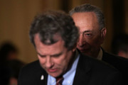 U.S. Sen. Sherrod Brown (D-OH) (L) speaks to members of the media as Senate Minority Leader Sen. Chuck Schumer (D-NY) (R) listens during a news briefing after the weekly Senate Democratic Policy Luncheon January 30, 2018 at the Capitol in Washington, DC. U.S. President Donald Trump will give his first State of the Union address during a joint session of the Congress tonight.